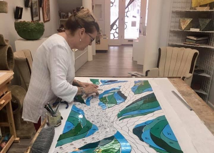 Michaele works on stained glass panel for Hope, Love and Faith Chapel