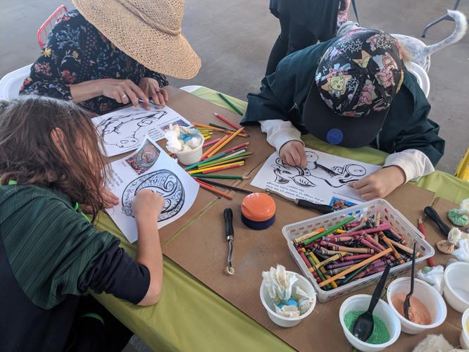 NHCC & AmeriCorps VISTAs lead an art education activity at the Railyards Market
