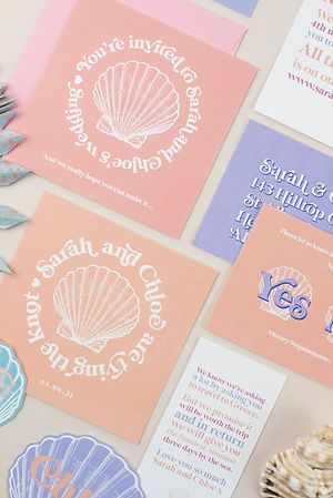 Beach inspired wedding stationery, invitation, save the date with shell design and peach, lilac colour palette