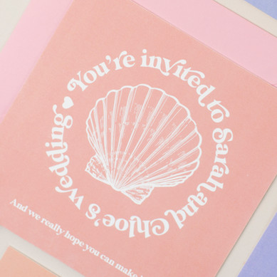 Beach inspired wedding stationery, invitation, save the date with shell design and peach, lilac colour palette, destination wedding