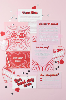 Fun, modern wedding stationery, invitation, save the date with red and pink colour palette and bursting heart design