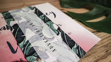 Modern tropical inspired wedding stationery, invitation, with a watercolour and banana leaf design perfect for a destination wedding by the sea.