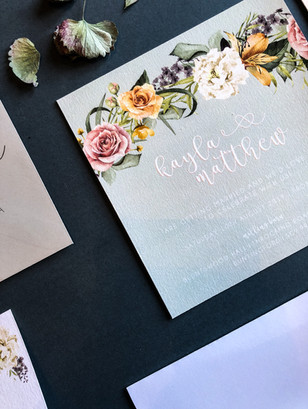 Elegant floral wedding stationery, invitation, accordion style in sage green with muted florals and foliage design. Perfect for a spring or summer wedding outdoors.