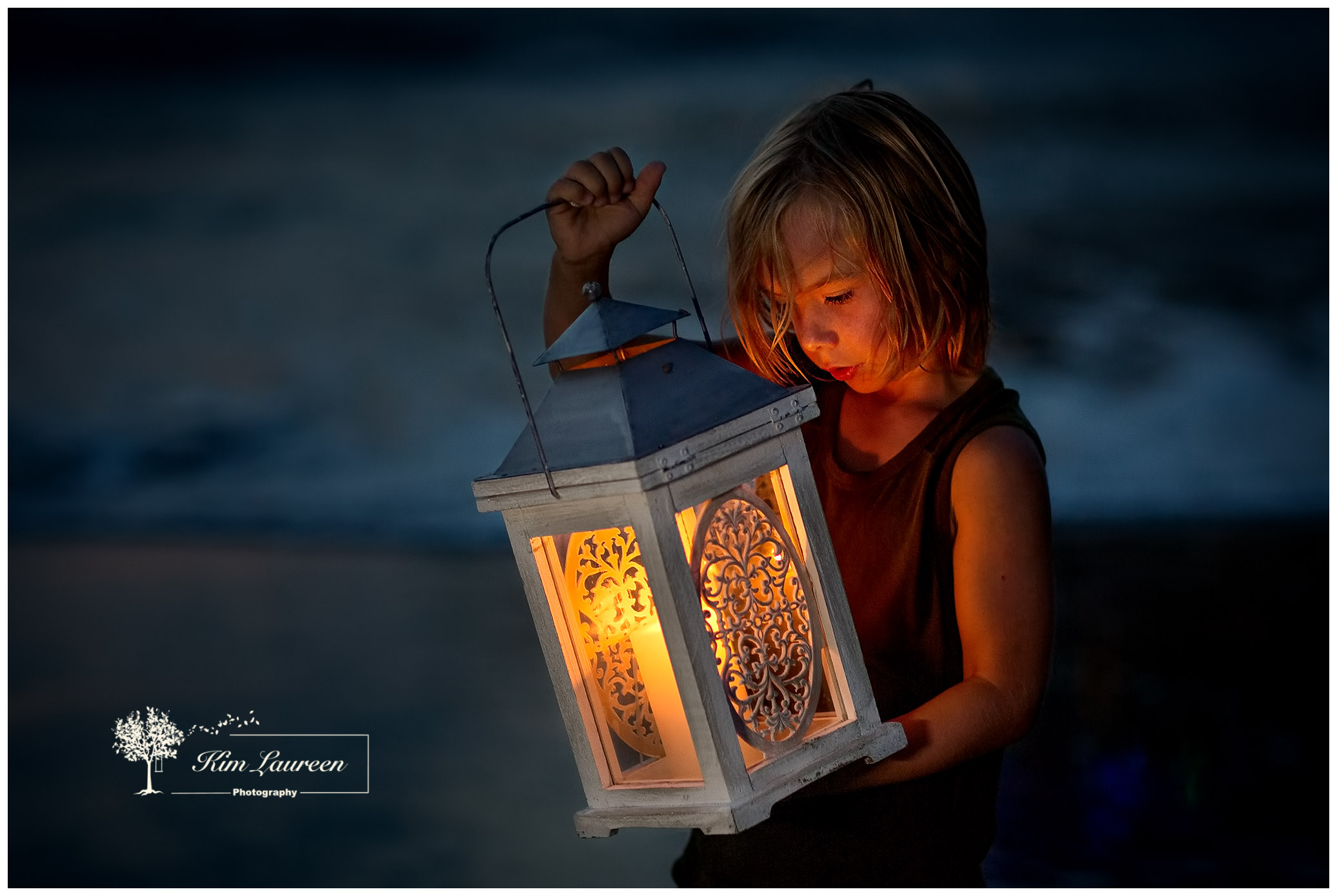 Blue hour Lantern boy on beach