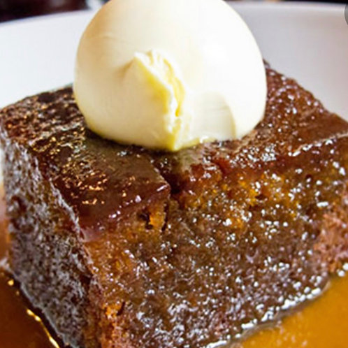 Home Made Sticky Toffee Pudding with butterscotch sauce.