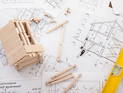 Engineer%20working%20on%20drawings%2C%20concept%20of%20building%20house_edited.jpg