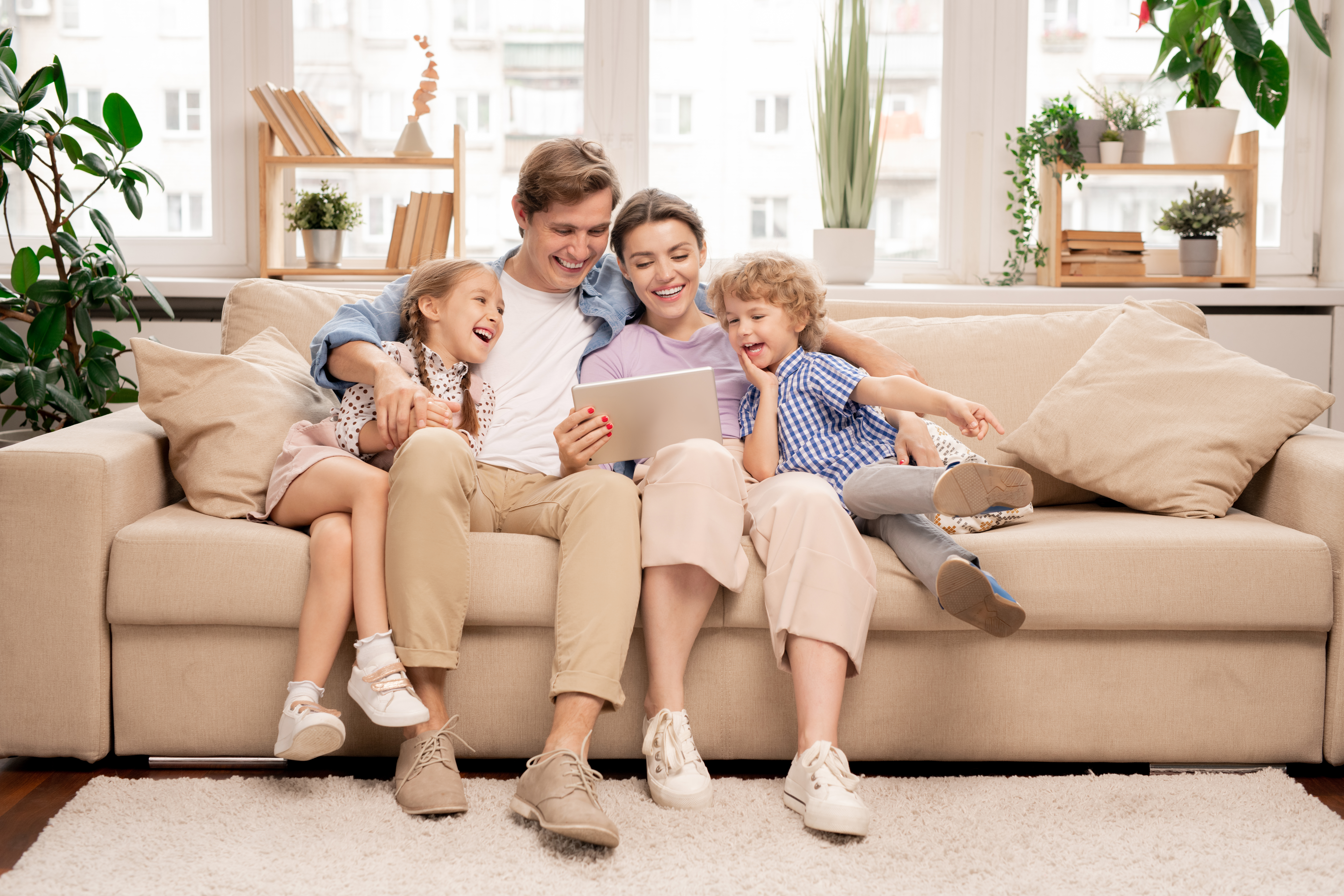 Young joyful casual family of two kids a