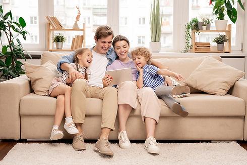 Family enjoying their new livingroom in their new family home