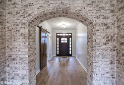 Sweeping brick archway in entrance hall