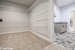 Walk-in master closet with laundry access