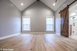 Cathedral ceiling and hardwood floors in master bedroom