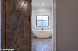 Barn door entrance to master bath