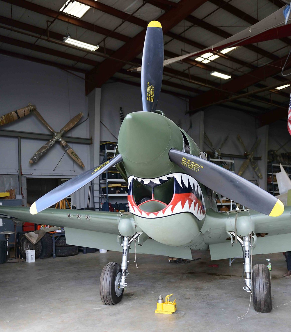 "The Curtiss P-40E Warbird is a single-engine, single-seat fighter aircraft. The popular shark mouth, well suited to the contours of the P-40, was made famous by the 1941 American Volunteer Group (AVG), also known as the ""Flying Tigers."" This partial aircraft was restored by the Yanks Air Museum and flew on  on 16th June 2018."