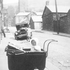 Early photo of Paul Pumford, in pram Elizabeth st Pentre