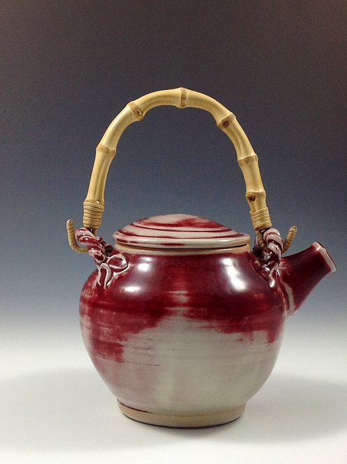 Red porcelain teapot with bamboo handle