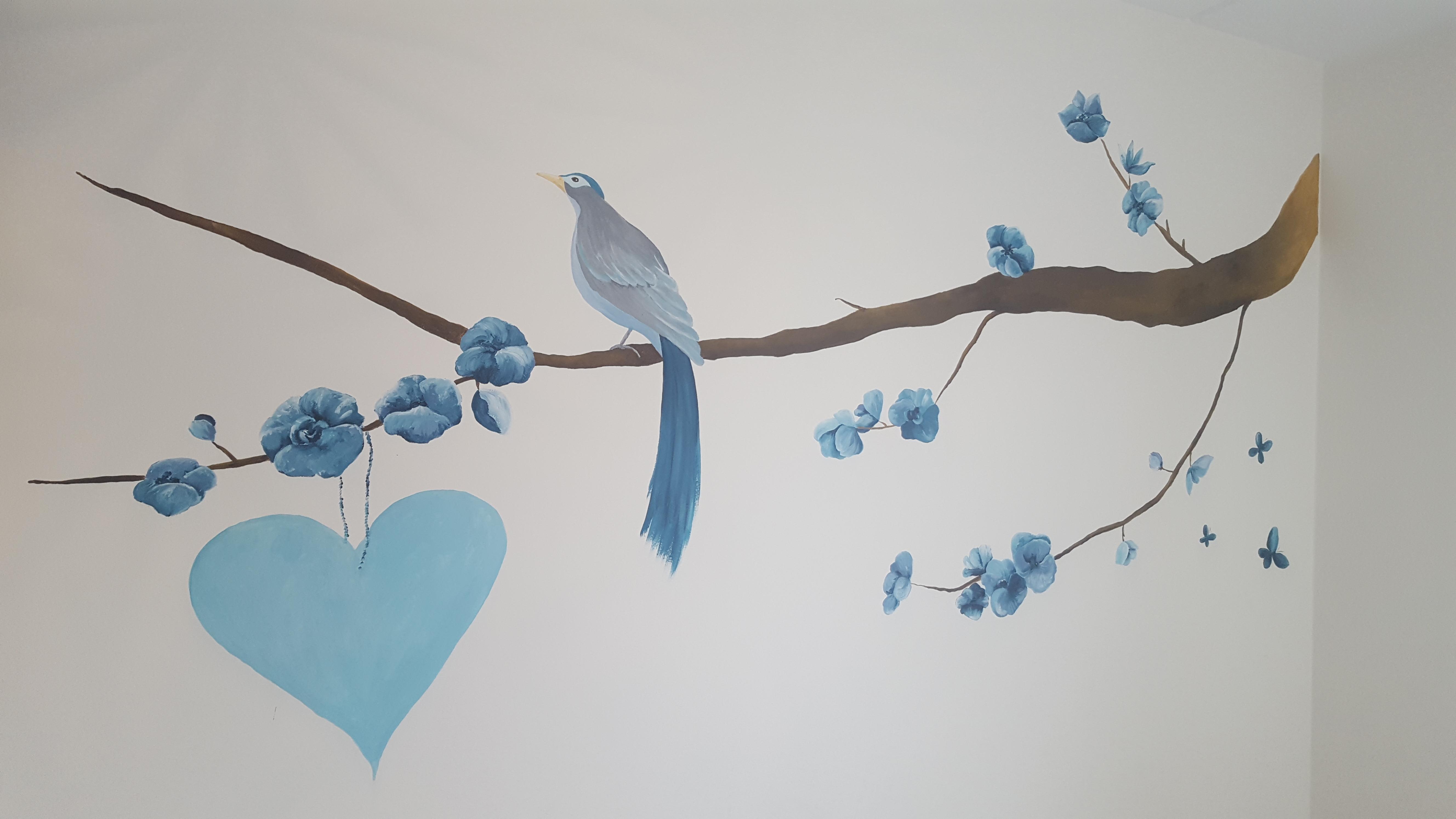 muurschildering vogel meisje