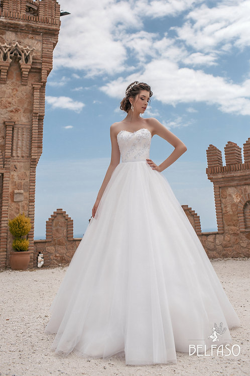 White wedding dress sweetheart neckline lace and beading detail simple