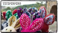 Oreilles Tipinpins.