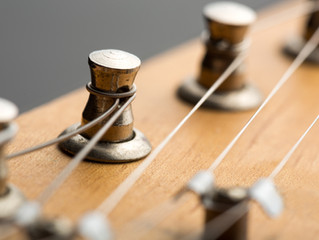 Restringing your Guitar or Violin                 - Why or When?