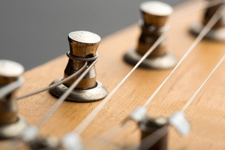 Instrument re-string and repair