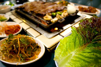 Ssam wraps in Korean, meat wrapped in lettuce and pepper sauce