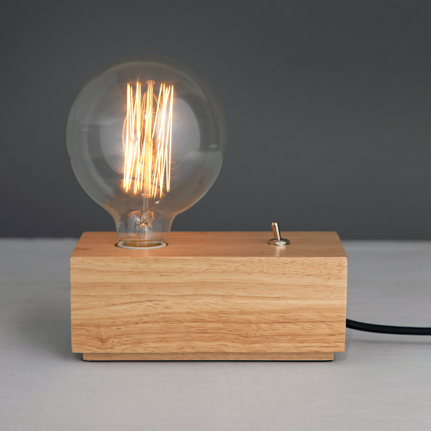 A Striking Yet Simple Table Lamp, The Vintage Flick Switch Table Lamp  Showcases A Stylish Filament Bulb For Stylish Retro Chic.