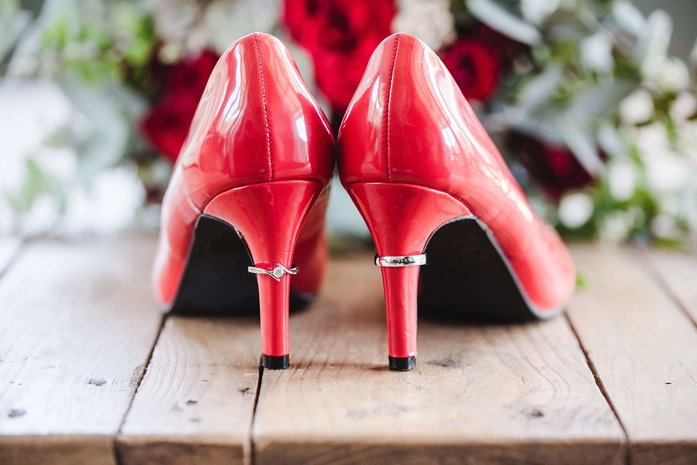 """alt=""""pair of red, lacquered high heel shoes ready for packing"""""""