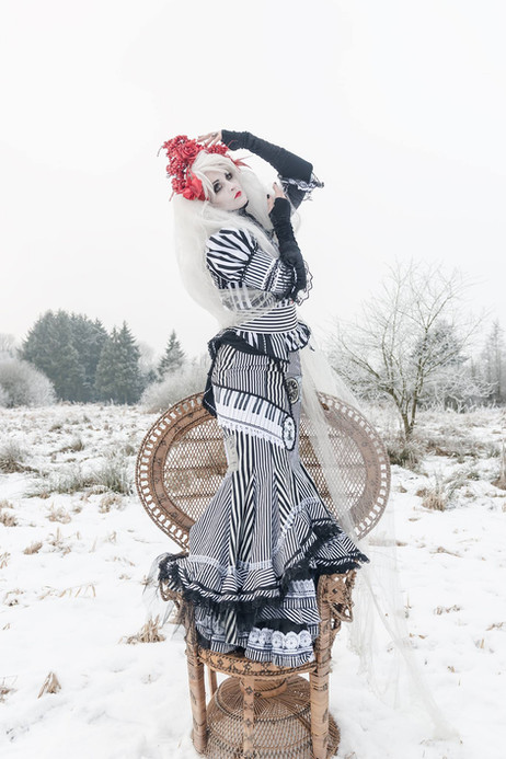 Model: S-T-A-R-gazer  Stripy Burtonesque dress made of parts of different sizzed stripes. The bodice is made after a Victorian pattern, it is tightly fitted and has a row of buttons for closure. Emily Autumn meets Alice in a Timburtonia winter fairytale!