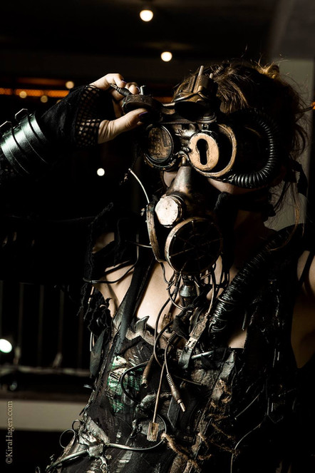 Photo by: Kira Hagen Photography  Model Dana  Close-up picture of the cyberpunk details. This is a complex costume with a lot of parts and small details but all united by a futuristic post-apocalyptic theme. All parts are salvaged from old computers and other electronics. The bodice and skirt are burtn faux leather. This is a great festival outfit, be it WGT or Burning Man. Many parts of it allow different options of styling.