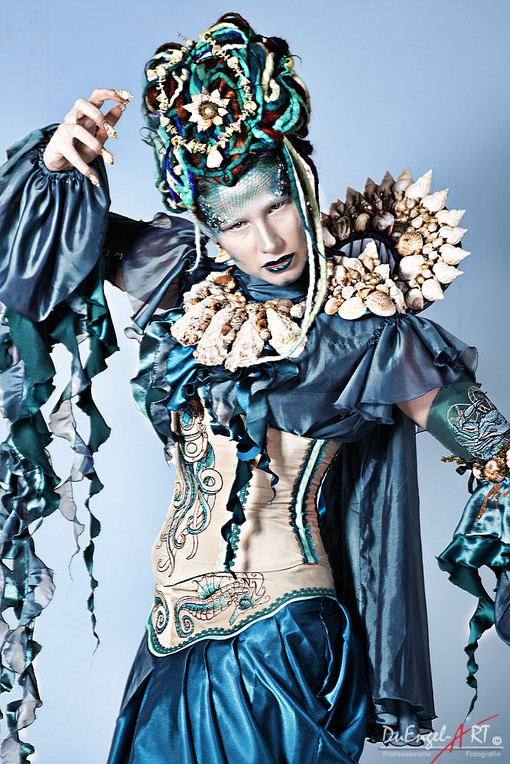 Photo by: Hans DuEngel Art Model: La Dutchessa  Diva Medusa is a very complex gown of many parts. The collar with eupaletts is a large piece that can also be worn separately. It is entirely handmade out of seashells gathered on the Atlantic coast. This outfit is ideal for a performer, because of its many parts it allows a lot of variation in wear and styling. Fantasy style gown for a festival, photoshoot or a drag queen - any concept art show or a performer would find a lot of uses for it.