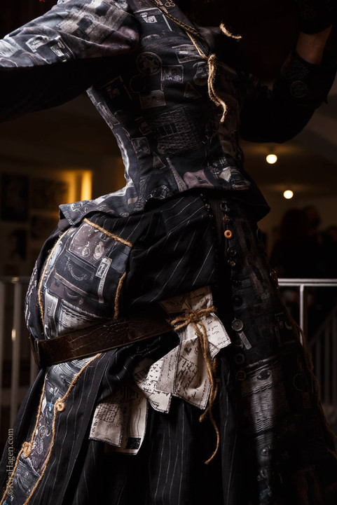by Kira Hagen Photography  Model La Dutchessa  Taken at Oh, Marisha! art exhibit and costumes show in Cologne, March 2018  This outfit was commissioned because of the fabric with suitcases print. The idea was to create a bustle dress for a travelling lady. But as she travels, she's got lost and not all her baggage is in one piece. She's lost some parts of the costume too, that's why parts of it are made from patches and joined together by rope and belts. Not all buttons are matching, and some of her luggage is coming lose, as can be seen on close-ups of the hat. The postcards and notes she's gathered through her journeys, are also stuck around her dress. This costume was a lot of fun to bring to life and reassured me once again that I would love to get involved in costume design and production for film.