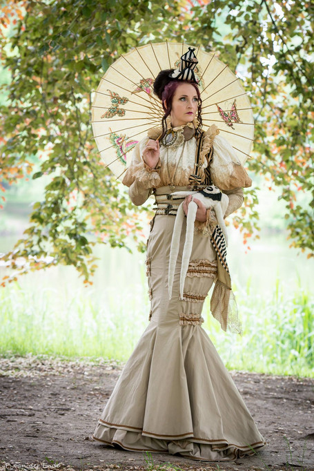 Photo by: Piet van der Ende Model: S-T-A-R-gazer  It is a light steampunk two-piece outfit, made of a blouse and a high-waisted skirt with a fishtail silhuette. Steampunk doll is very noticable, stralling throrugh a festival or a Victorian picnic.