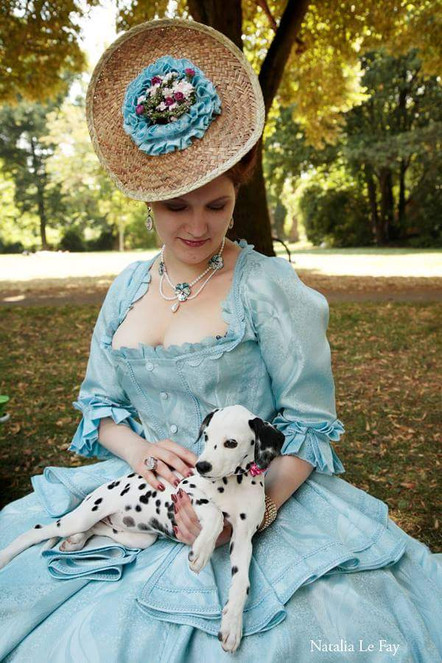 Photo by Natalia LeFay  Model Oh, Marisha!  This is my dalmatian, whe she was only 9 weeks old but already accompanying me at the historical picnics. This one was at our annual pre-Amphi picnic in Cologne. I am wearing a rococo-inspired ensemble in light blue, with a self-made hat made out from an old straw fedora. Later on this dress went onto the professional opera singer, who uses it in her live open air performances.