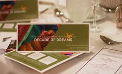 Decade of Dreams brochure on table