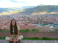 Young Ashli with the beautiful city of Ollantaytambo in the background