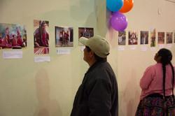 Man examining photographs
