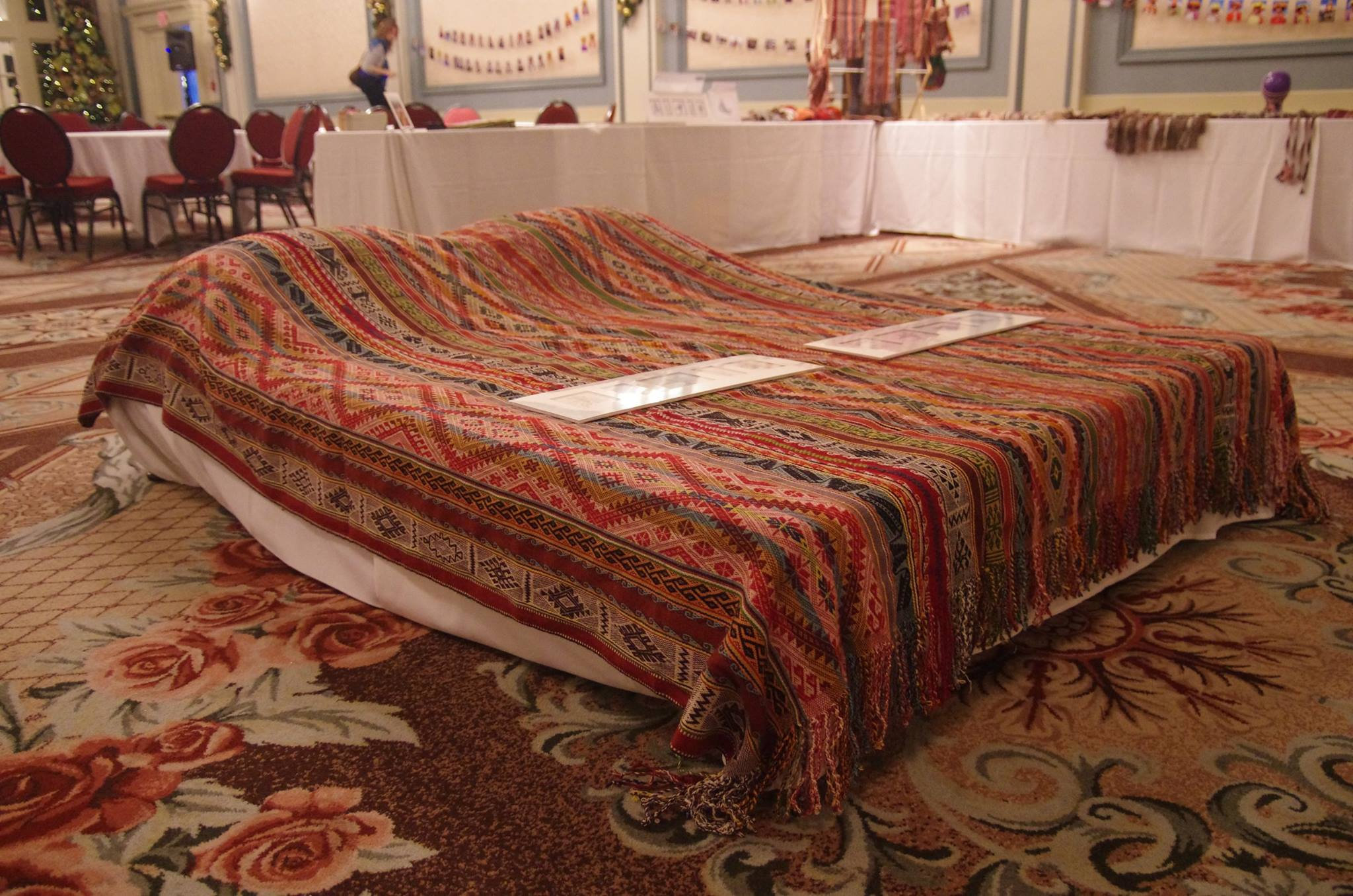 Textile bedspread on display