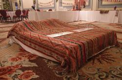 Textile bedspread on display