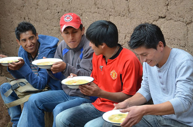 T'ikary Youth students eating soup