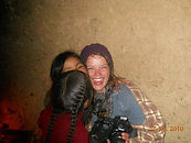 Ashli laughing with two small Quechua girls