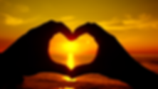 ocean-sunset-shining-through-heart-shape