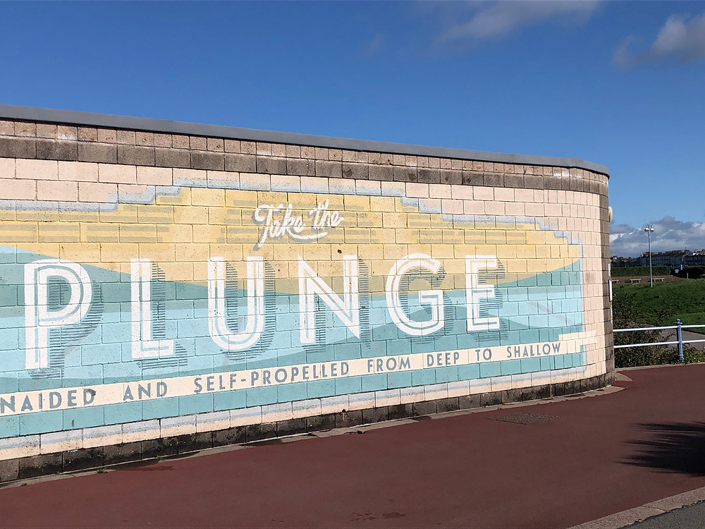 "Art Deco bathing sign from Morecambe sea front saying ""take the plunge"""