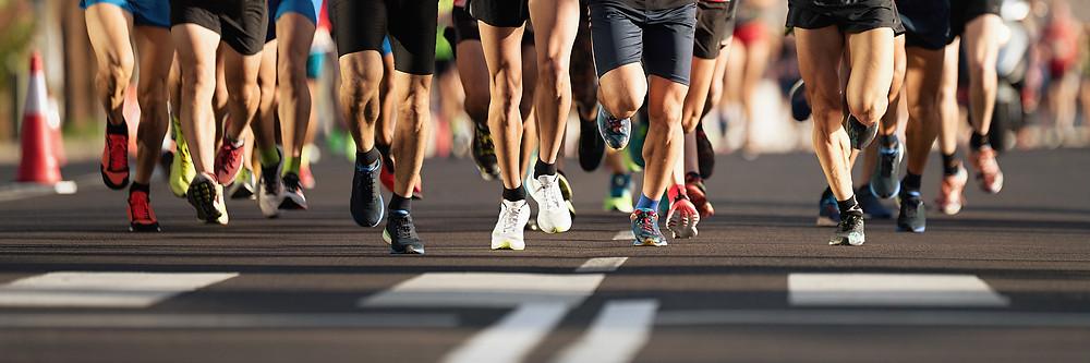 Marathon runners pounding tarmac