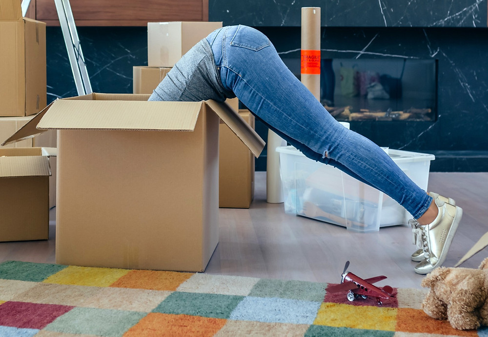 Woman leaning into a packing box