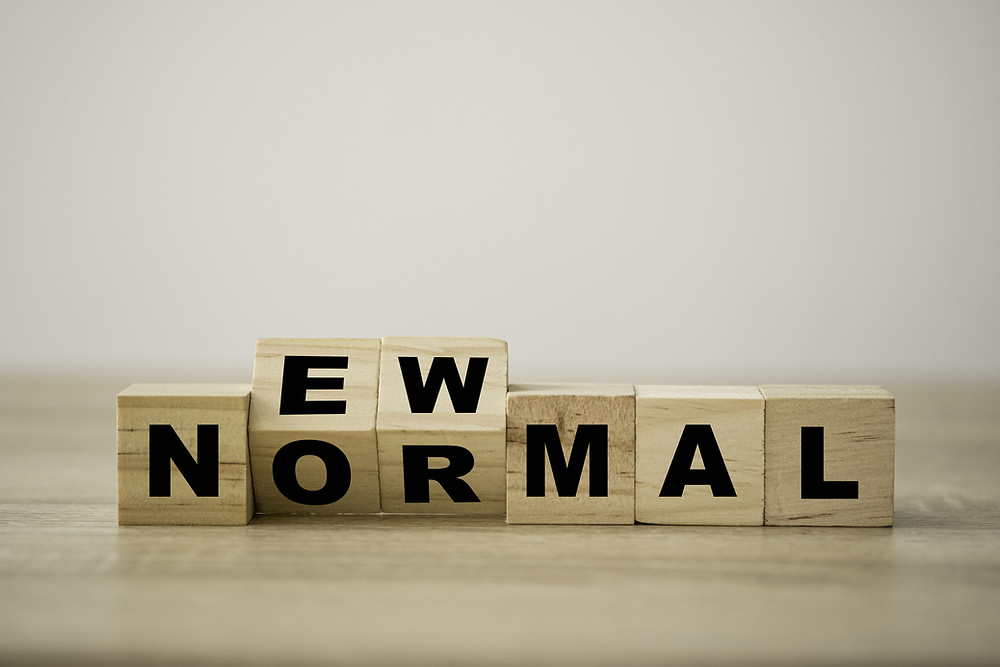 Wooden blocks with letters spelling out 'New Normal'
