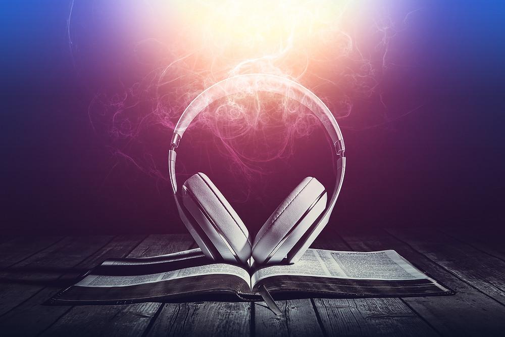 Headphones open book audiobooks