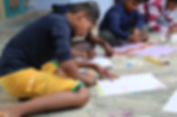 Rescued trafficked children doing art