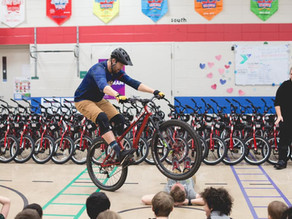 68 Local First Graders Surprised with Free Bikes from Can'd Aid