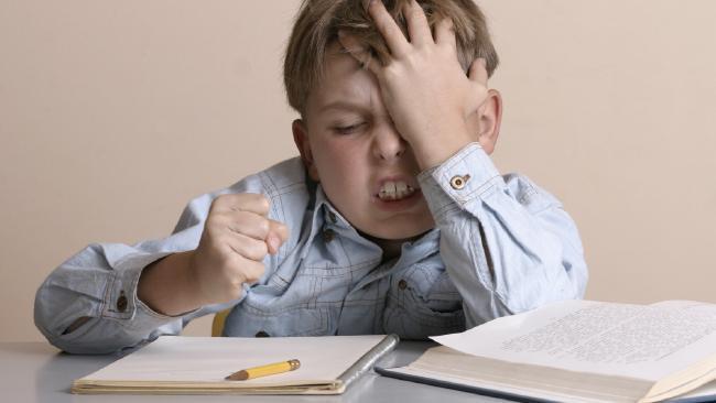 Frustrated kid doing homework