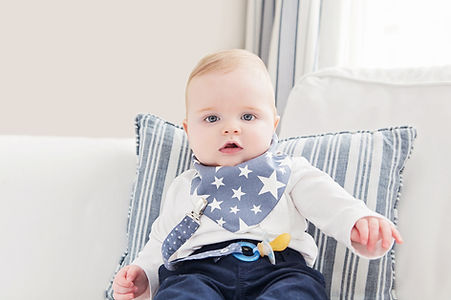 House of Bibs London beautiful baby boy wearing denim blue stars cotton oeko tex waterproof impermeable bandana dribble bibs and steel blue dummy clip baby gifts
